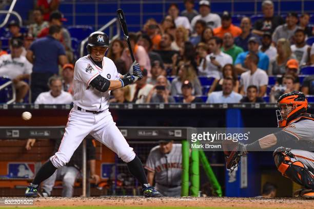 Ichiro Suzuki of the Miami Marlins singles in the seventh inning during the game between the Miami Marlins and the San Francisco Giants at Marlins...