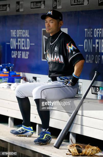 Ichiro Suzuki of the Miami Marlins sits in the dugout before the start of a game against the New York Mets at Citi Field on May 5 2017 in the...