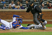 Ichiro Suzuki of the Miami Marlins slides into home as Travis d'Arnaud of the New York Mets tries to make the tag on April 16 2015 at Citi Field in...