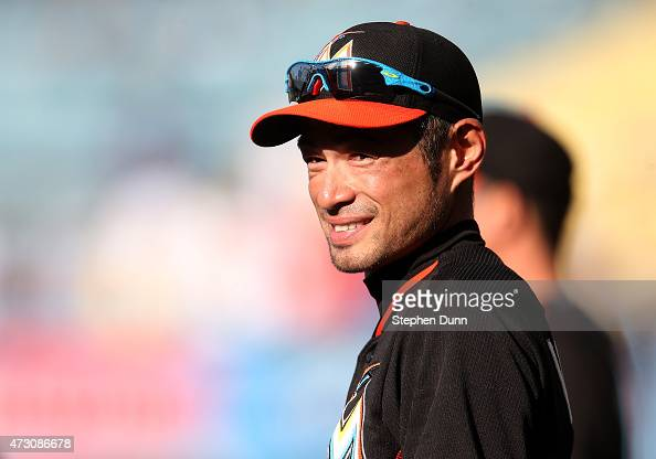 Ichiro Suzuki of the Miami Marlins smiles as he waits to take batting practice for the game with the Los Angeles Dodgers at Dodger Stadium on May 12...
