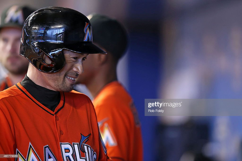 Ichiro Suzuki #51 of the Miami Marlins smiles in the dugout after scoring a run during the first inning of the game against the San Diego Padres at Marlins Park on August 2, 2015 in Miami, Florida.