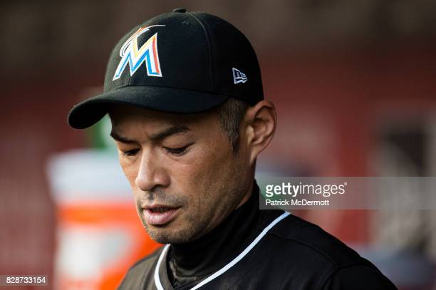 Ichiro Suzuki of the Miami Marlins stands in the dugout in the second inning during a game against the Washington Nationals at Nationals Park on...