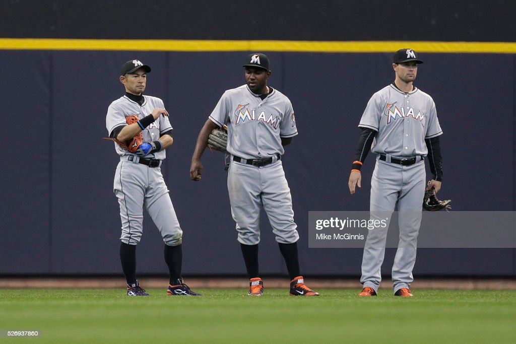 Ichiro Suzuki #51 of the Miami Marlins stands in the outfield with Marcell Ozuna #13 and Cole Gillespie #28 during the eighth inning against the Milwaukee Brewers at Miller Park on May 01, 2016 in Milwaukee, Wisconsin.