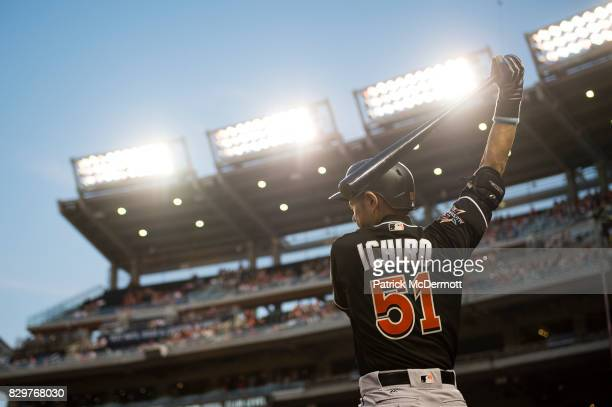 Ichiro Suzuki of the Miami Marlins stands on deck in the fourth inning during a game against the Washington Nationals at Nationals Park on August 9...