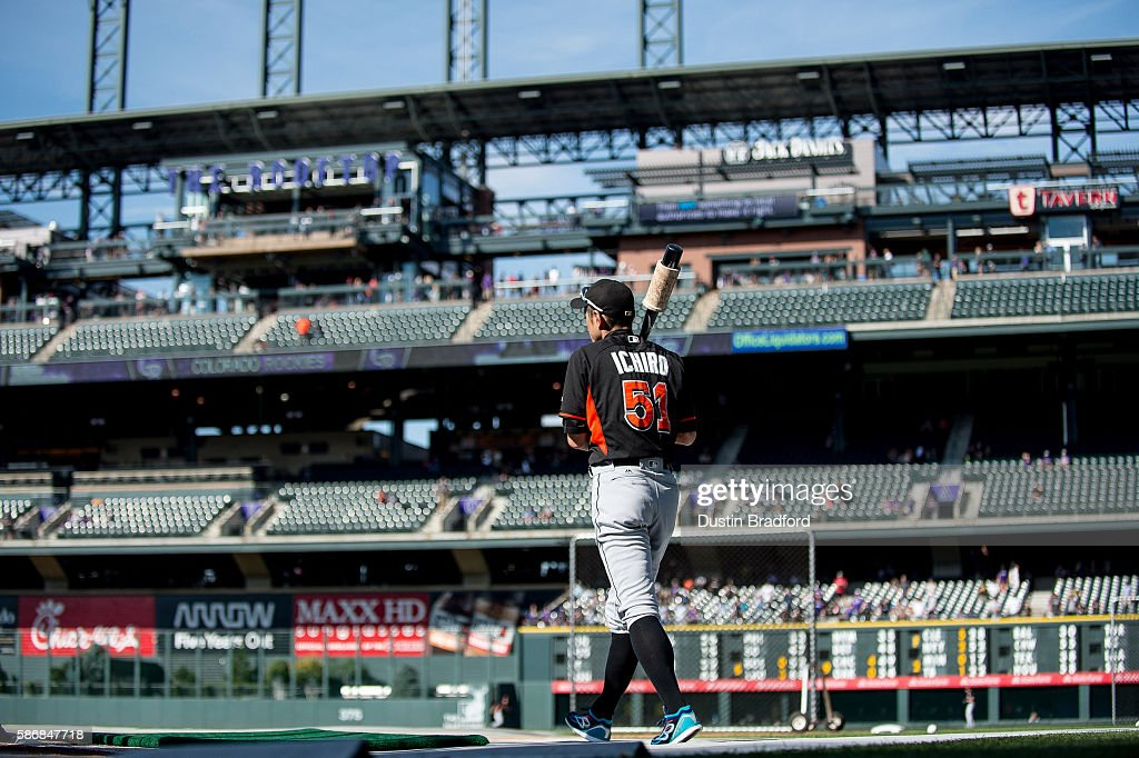 Ichiro Suzuki #51 of the Miami Marlins stands on the field and warms up during batting practice before a game against the Colorado Rockies at Coors Field on August 6, 2016 in Denver, Colorado.