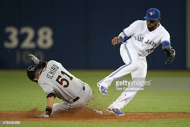 Ichiro Suzuki of the Miami Marlins steals second base in the fifth inning during MLB game action as Jose Reyes of the Toronto Blue Jays is unable to...
