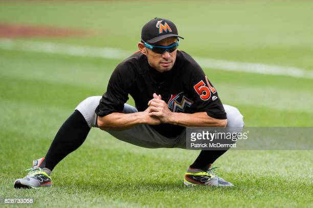 Ichiro Suzuki of the Miami Marlins stretches during batting practice before a game against the Washington Nationals at Nationals Park on August 9...