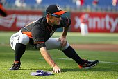 Ichiro Suzuki of the Miami Marlins stretches during warm ups before the start of a game against the Philadelphia Phillies at Citizens Bank Park on...