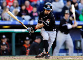 Ichiro Suzuki of the Miami Marlins strikes out during the eighth inning of an MLB game against the Philadelphia Phillies at Citizens Bank Park on...