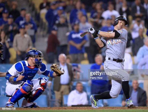 Ichiro Suzuki of the Miami Marlins strikes out to end the game in front of Yasmani Grandal of the Los Angeles Dodgers for a 72 Dodger win at Dodger...