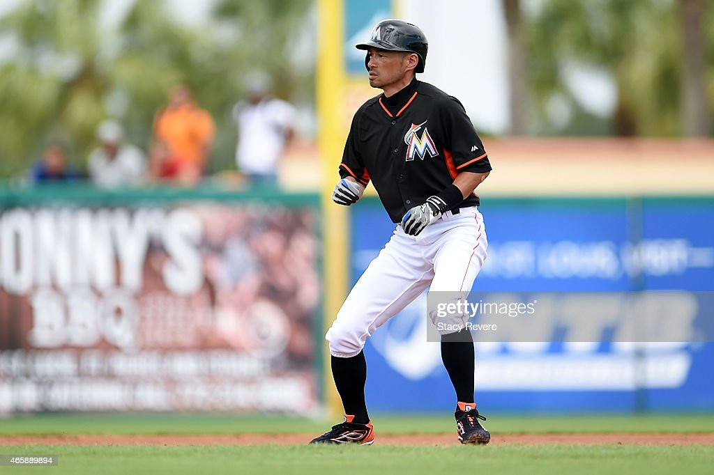 Ichiro Suzuki #51 of the Miami Marlins takes a lead from second base during a spring training game against the New York Mets at Roger Dean Stadium on March 11, 2015 in Jupiter, Florida.