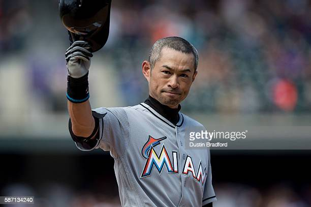 Ichiro Suzuki of the Miami Marlins tips his hat to the crowd after hitting a seventh inning triple against the Colorado Rockies for the 3000th hit of...