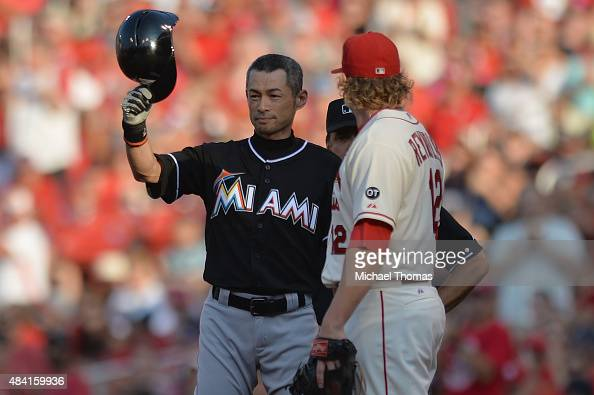 Ichiro Suzuki of the Miami Marlins tips his helmet to the crowd after hitting a single in the first inning against the St Louis Cardinals at Busch...