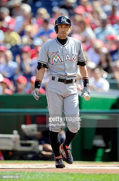 Ichiro Suzuki of the Miami Marlins walks to the dugout after striking out in the first inning against the Washington Nationals at Nationals Park on...