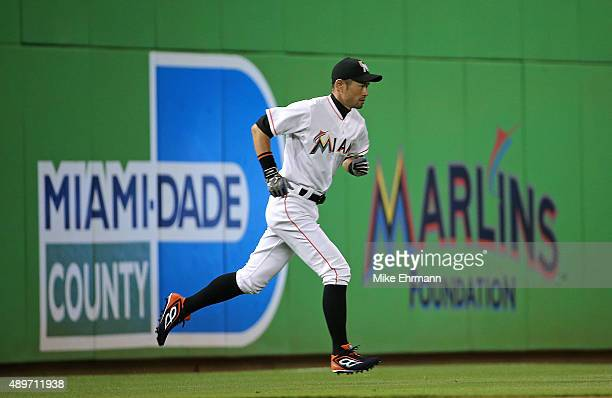 Ichiro Suzuki of the Miami Marlins warms up during a game against the Philadelphia Phillies at Marlins Park on September 23 2015 in Miami Florida