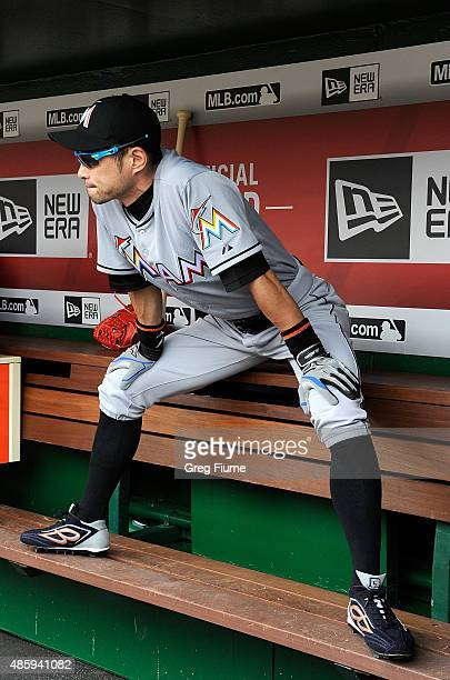 Ichiro Suzuki of the Miami Marlins warms up in the dugout before the game against the Washington Nationals at Nationals Park on August 30 2015 in...