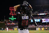 Ichiro Suzuki of the Miami Marlins warmsup in the ondeck circle in the ninth inning during a game against the Philadelphia Phillies at Citizens Bank...