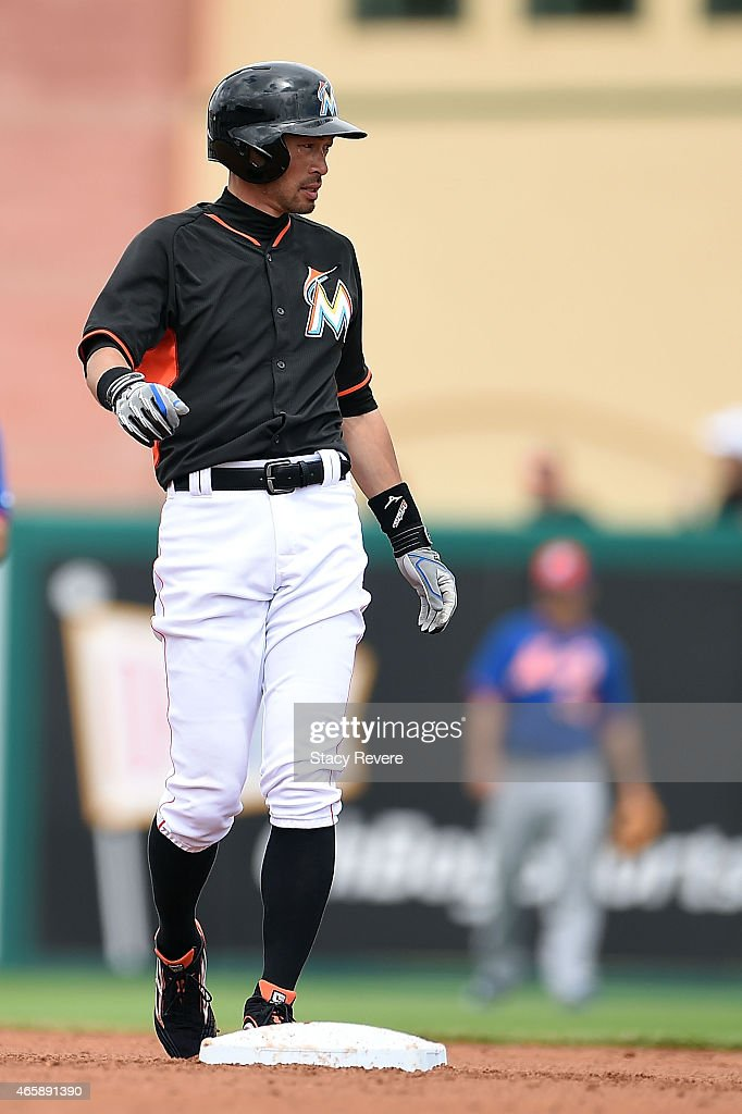 Ichiro Suzuki #51 of the Miami Marlins watches a ball from second base during a spring training game against the New York Mets at Roger Dean Stadium on March 11, 2015 in Jupiter, Florida.