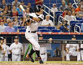 Ichiro Suzuki of the Miami Marlins watches his RBI single in the second inning against the Boston Red Sox at Marlins Park on August 12 2015 in Miami...