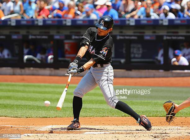 Ichiro Suzuki of the Miami Marlinshits a single in the second inning against the New York Mets during their game at Citi Field on May 31 2015 in New...