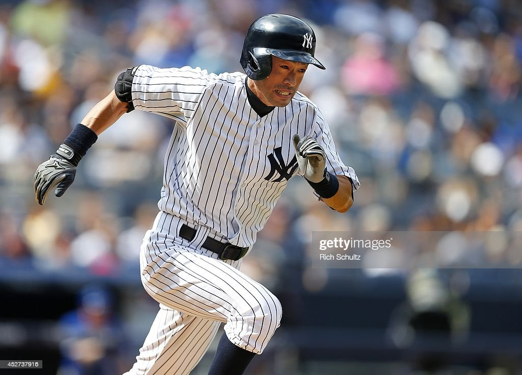 <a gi-track='captionPersonalityLinkClicked' href=/galleries/search?phrase=Ichiro+Suzuki&family=editorial&specificpeople=201556 ng-click='$event.stopPropagation()'>Ichiro Suzuki</a> #31 of the New York Yankees attempts to beat the throw to first on a ground ball in the eighth inning against the Toronto Blue Jays during a MLB baseball game at Yankee Stadium on July 26, 2014 in the Bronx borough of New York City. The Blue Jays defeated the Yankees 6-4.