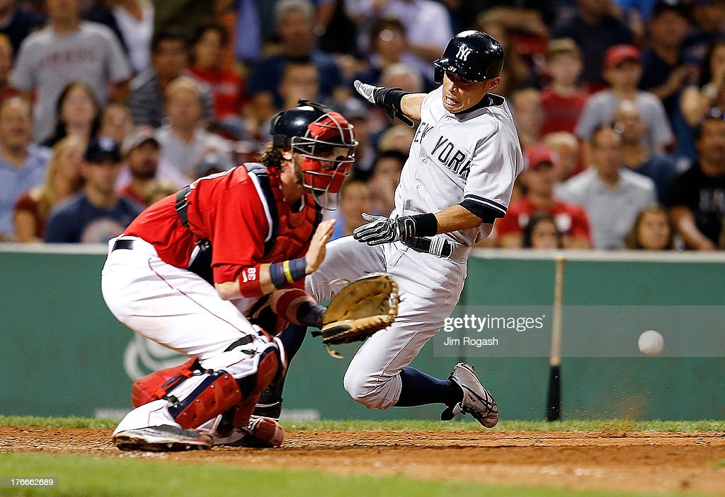 <a gi-track='captionPersonalityLinkClicked' href=/galleries/search?phrase=Ichiro+Suzuki&family=editorial&specificpeople=201556 ng-click='$event.stopPropagation()'>Ichiro Suzuki</a> #31 of the New York Yankees beats the throw to the plate to <a gi-track='captionPersonalityLinkClicked' href=/galleries/search?phrase=Jarrod+Saltalamacchia&family=editorial&specificpeople=836404 ng-click='$event.stopPropagation()'>Jarrod Saltalamacchia</a> #39 of the Boston Red Sox in the 9th inning to score at Fenway Park on August 16, 2013 in Boston, Massachusetts.