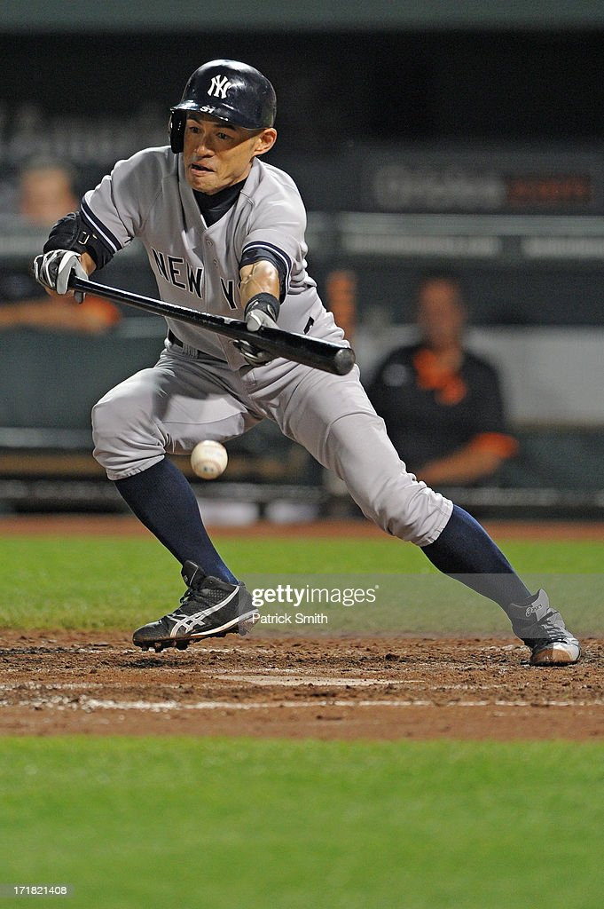 <a gi-track='captionPersonalityLinkClicked' href=/galleries/search?phrase=Ichiro+Suzuki&family=editorial&specificpeople=201556 ng-click='$event.stopPropagation()'>Ichiro Suzuki</a> #31 of the New York Yankees bunts against the Baltimore Orioles in the seventh inning at Oriole Park at Camden Yards on June 28, 2013 in Baltimore, Maryland. The Baltimore Orioles won, 4-3.