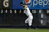 Ichiro Suzuki of the New York Yankees catches a fly ball in the second inning against the Tampa Bay Rays at Yankee Stadium on September 11 2014 in...
