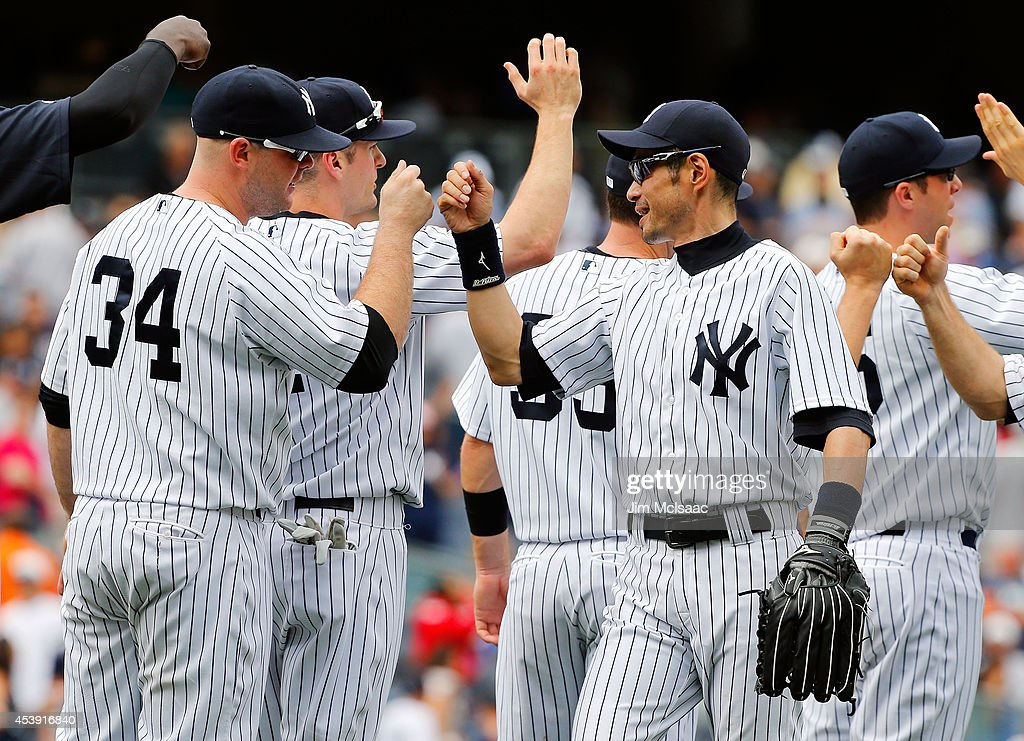 Ichiro Suzuki #31 of the New York Yankees celebrates after defeating the Houston Astros with teammate Brian McCann #34 against the at Yankee Stadium on August 21, 2014 in the Bronx borough of New York City.