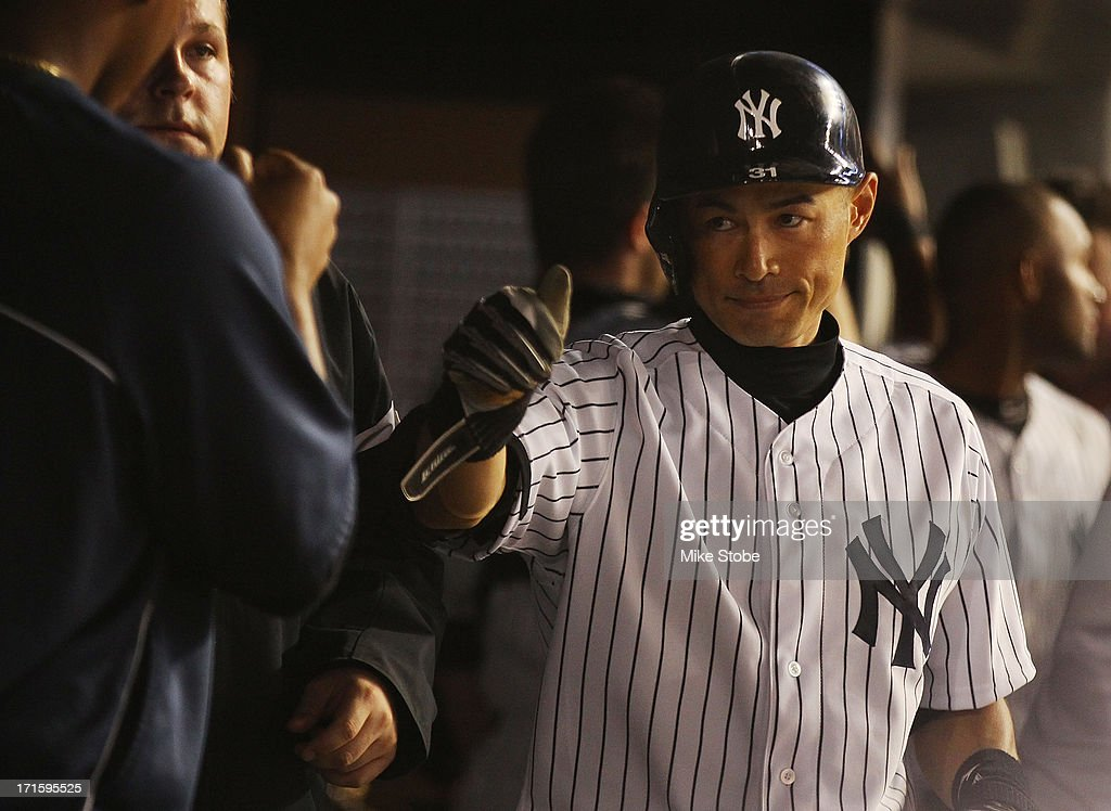 Ichiro Suzuki #31 of the New York Yankees celebrates in the dugout after hitting a two run home run in the seventh inning against the Texas Rangers at Yankee Stadium on June 26, 2013 in the Bronx borough of New York City.
