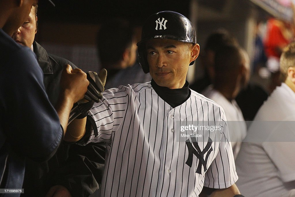 Ichiro Suzuki #31 of the New York Yankees celebrates in the dugout after hitting a two run home run in the seventh inning against the Texas Rangers at Yankee Stadium on June 26, 2013 in the Bronx borough of New York City. Rangers defeated the Yankees 8-5.