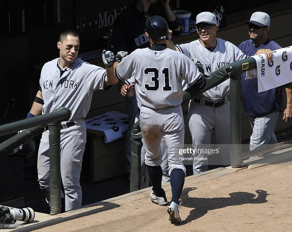 <a gi-track='captionPersonalityLinkClicked' href=/galleries/search?phrase=Ichiro+Suzuki&family=editorial&specificpeople=201556 ng-click='$event.stopPropagation()'>Ichiro Suzuki</a> #31 of the New York Yankees celebrates scoring a run against the Minnesota Twins during the sixth inning of the game on July 4, 2013 at Target Field in Minneapolis, Minnesota.