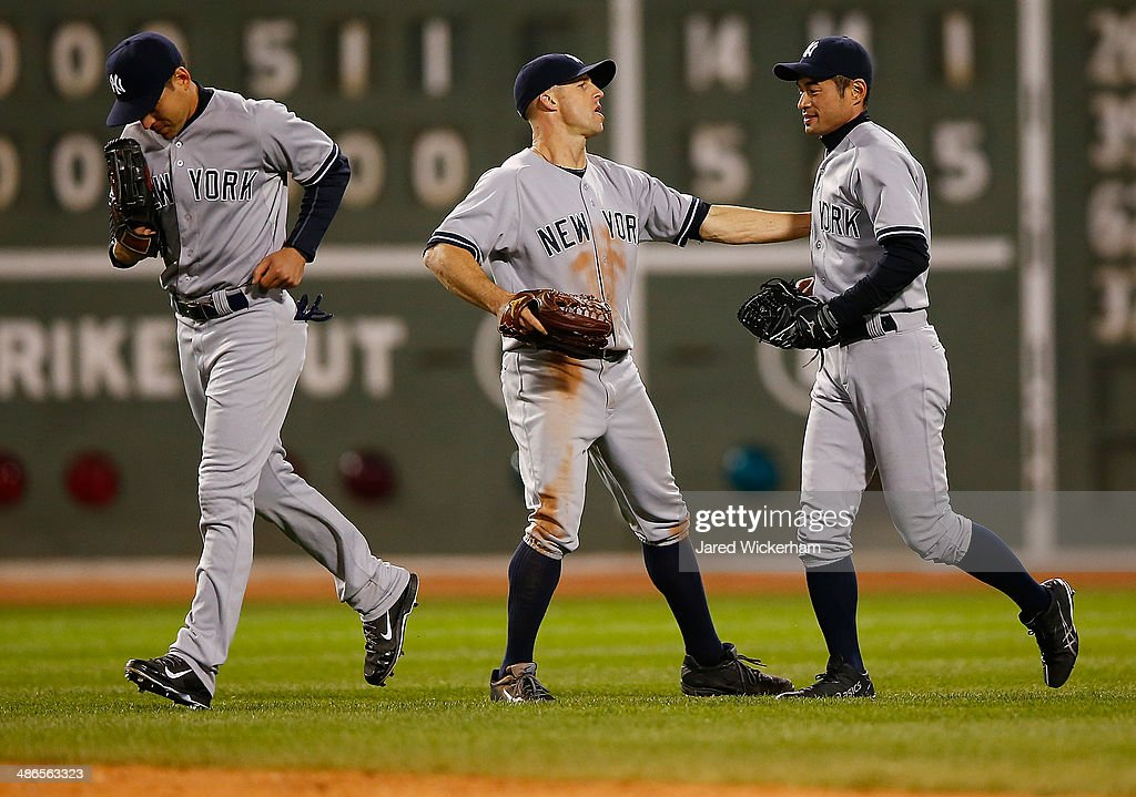 <a gi-track='captionPersonalityLinkClicked' href=/galleries/search?phrase=Ichiro+Suzuki&family=editorial&specificpeople=201556 ng-click='$event.stopPropagation()'>Ichiro Suzuki</a> #31 of the New York Yankees celebrates their 14-4 win with teammate <a gi-track='captionPersonalityLinkClicked' href=/galleries/search?phrase=Brett+Gardner&family=editorial&specificpeople=4172518 ng-click='$event.stopPropagation()'>Brett Gardner</a> #11 against the Boston Red Sox during the game at Fenway Park on April 24, 2014 in Boston, Massachusetts.