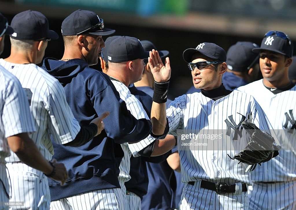 Ichiro Suzuki #31 of the New York Yankees (C) celebrates with his teammates at the end of their ball game against the Toronto Blue Jays during the first game of a double header at Yankee Stadium on September 19, 2012 in the Bronx borough of New York City.