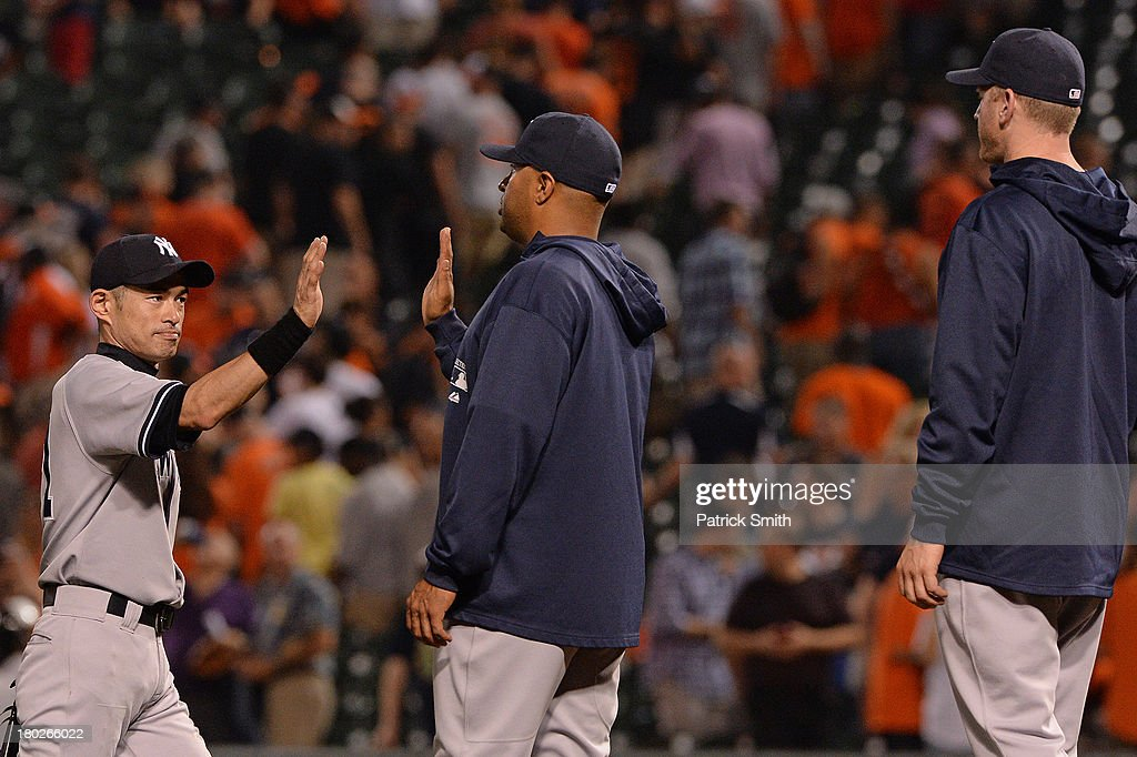 <a gi-track='captionPersonalityLinkClicked' href=/galleries/search?phrase=Ichiro+Suzuki&family=editorial&specificpeople=201556 ng-click='$event.stopPropagation()'>Ichiro Suzuki</a> #31 of the New York Yankees celebrates with teammates after defeating the Baltimore Orioles at Oriole Park at Camden Yards on September 10, 2013 in Baltimore, Maryland.
