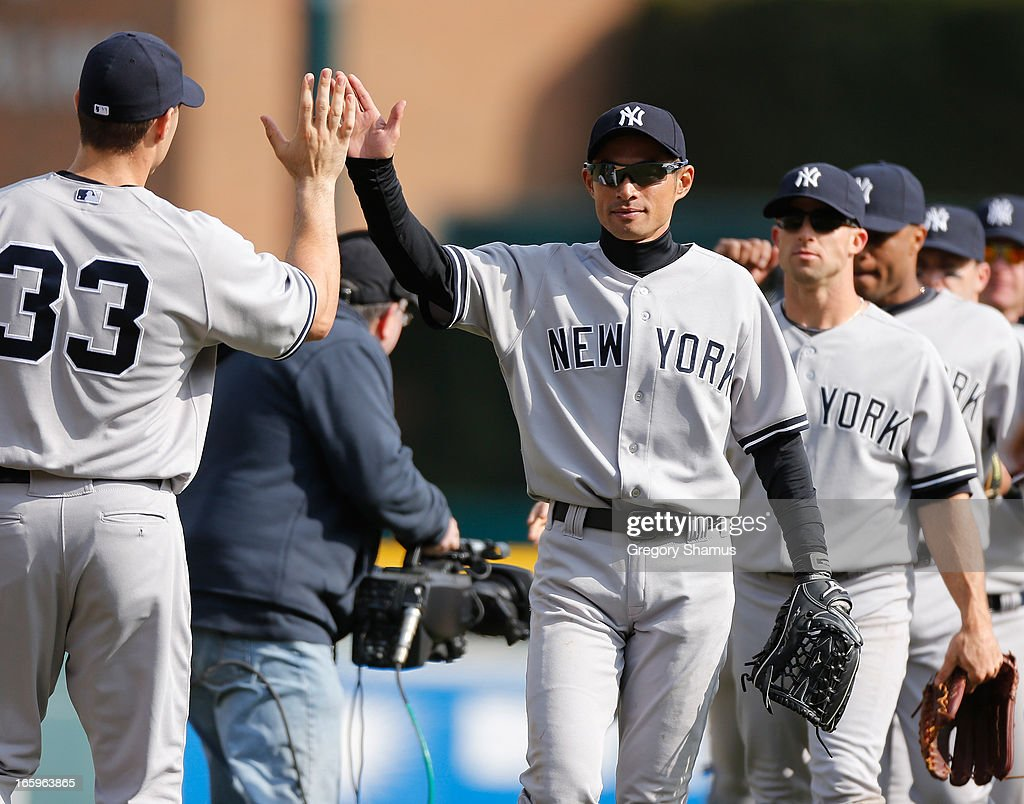 <a gi-track='captionPersonalityLinkClicked' href=/galleries/search?phrase=Ichiro+Suzuki&family=editorial&specificpeople=201556 ng-click='$event.stopPropagation()'>Ichiro Suzuki</a> #31 of the New York Yankees celebrators a 7-0 win over the Detroit Tigers with Travis Hafner #33 and the rest of his teammates at Comerica Park on April 7, 2013 in Detroit, Michigan.