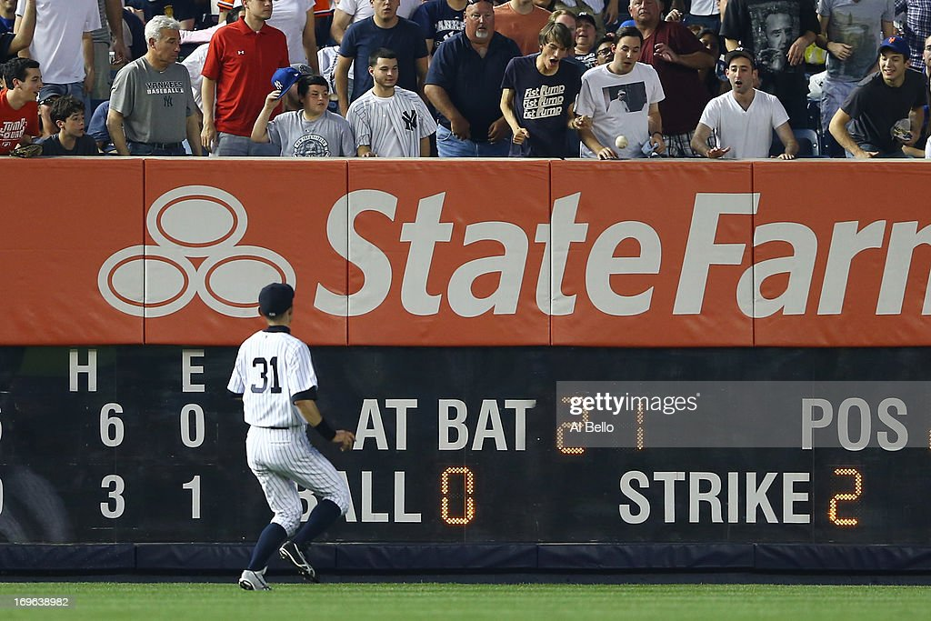 <a gi-track='captionPersonalityLinkClicked' href=/galleries/search?phrase=Ichiro+Suzuki&family=editorial&specificpeople=201556 ng-click='$event.stopPropagation()'>Ichiro Suzuki</a> #31 of the New York Yankees chases a double hit by Lucas Duda #21 of the New York Mets in the fourth inning during their game on May 29, 2013 at Yankee Stadium in the Bronx borough of New York City