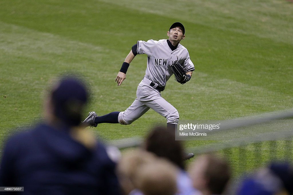 <a gi-track='captionPersonalityLinkClicked' href=/galleries/search?phrase=Ichiro+Suzuki&family=editorial&specificpeople=201556 ng-click='$event.stopPropagation()'>Ichiro Suzuki</a> #31 of the New York Yankees chases a fly ball hit in the top of the ninth inning against the Milwaukee Brewers during the Interleague game at Miller Park on May 09, 2014 in Milwaukee, Wisconsin.