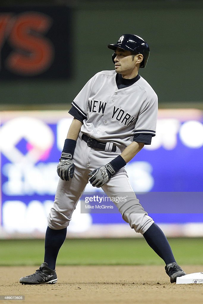 <a gi-track='captionPersonalityLinkClicked' href=/galleries/search?phrase=Ichiro+Suzuki&family=editorial&specificpeople=201556 ng-click='$event.stopPropagation()'>Ichiro Suzuki</a> #31 of the New York Yankees comes into the game to pinch run in the top of the eighth inning against the Milwaukee Brewers during the interleague game at Miller Park on May 09, 2014 in Milwaukee, Wisconsin.