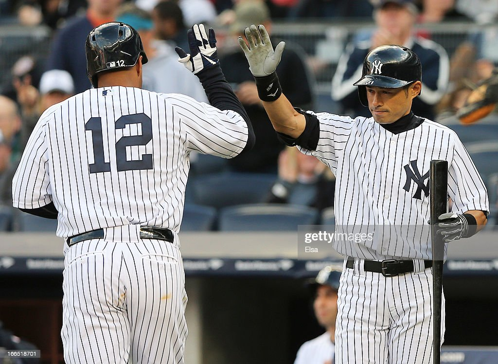 <a gi-track='captionPersonalityLinkClicked' href=/galleries/search?phrase=Ichiro+Suzuki&family=editorial&specificpeople=201556 ng-click='$event.stopPropagation()'>Ichiro Suzuki</a> #31 of the New York Yankees congratulates teammate <a gi-track='captionPersonalityLinkClicked' href=/galleries/search?phrase=Vernon+Wells&family=editorial&specificpeople=212943 ng-click='$event.stopPropagation()'>Vernon Wells</a> #12 after Wells hit a solo home run in the sixth inning against the Baltimore Orioles on April 13, 2013 at Yankee Stadium in the Bronx borough of New York City.