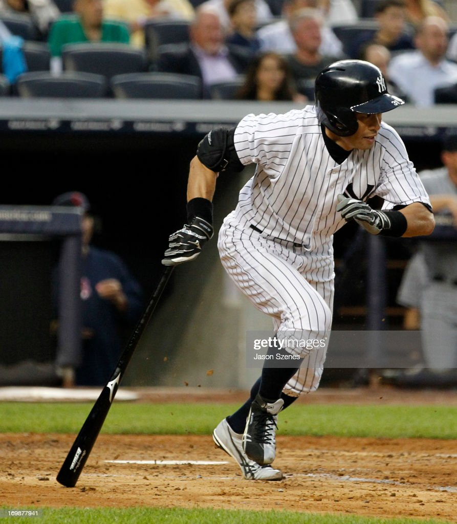 <a gi-track='captionPersonalityLinkClicked' href=/galleries/search?phrase=Ichiro+Suzuki&family=editorial&specificpeople=201556 ng-click='$event.stopPropagation()'>Ichiro Suzuki</a> #31 of the New York Yankees connects on a single to center field against the Cleveland Indians at Yankees Stadium on June 3, 2013 in the Bronx borough of New York City. (Photo by Jason Szenes/Getty Images