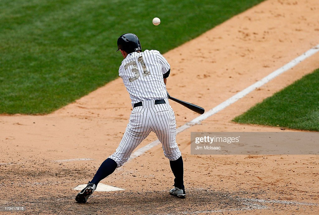 <a gi-track='captionPersonalityLinkClicked' href=/galleries/search?phrase=Ichiro+Suzuki&family=editorial&specificpeople=201556 ng-click='$event.stopPropagation()'>Ichiro Suzuki</a> #31 of the New York Yankees connects on an eighth inning base hit against the Minnesota Twins at Yankee Stadium on July 13, 2013 in the Bronx borough of New York City. The Twins defeated the Yankees 4-1.