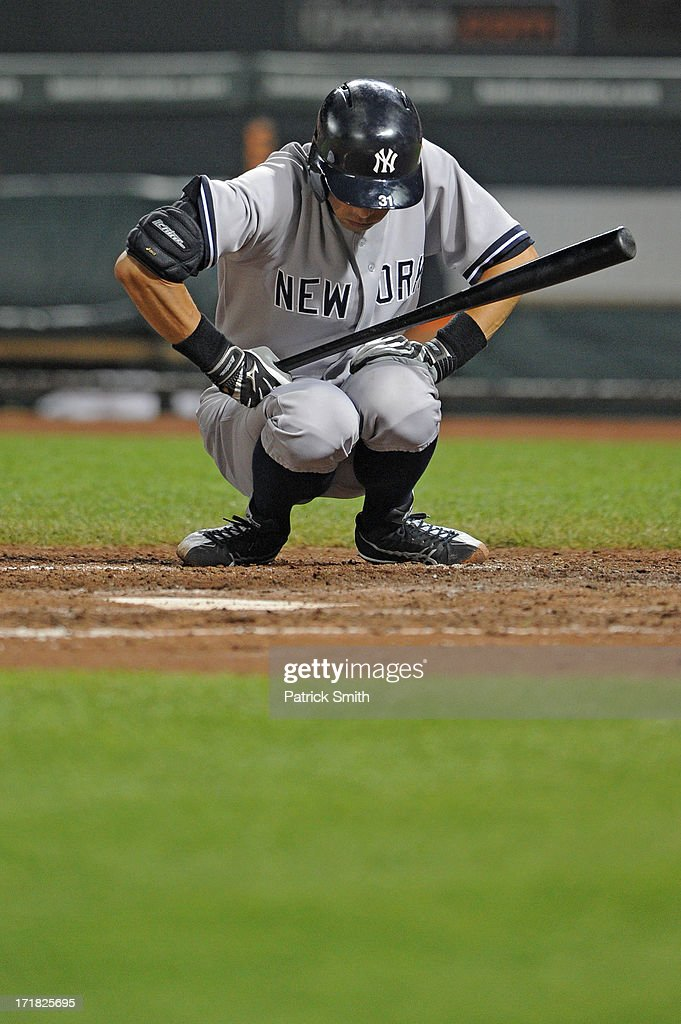 <a gi-track='captionPersonalityLinkClicked' href=/galleries/search?phrase=Ichiro+Suzuki&family=editorial&specificpeople=201556 ng-click='$event.stopPropagation()'>Ichiro Suzuki</a> #31 of the New York Yankees crouches during the game against the Baltimore Orioles at Oriole Park at Camden Yards on June 28, 2013 in Baltimore, Maryland. The Baltimore Orioles won, 4-3.