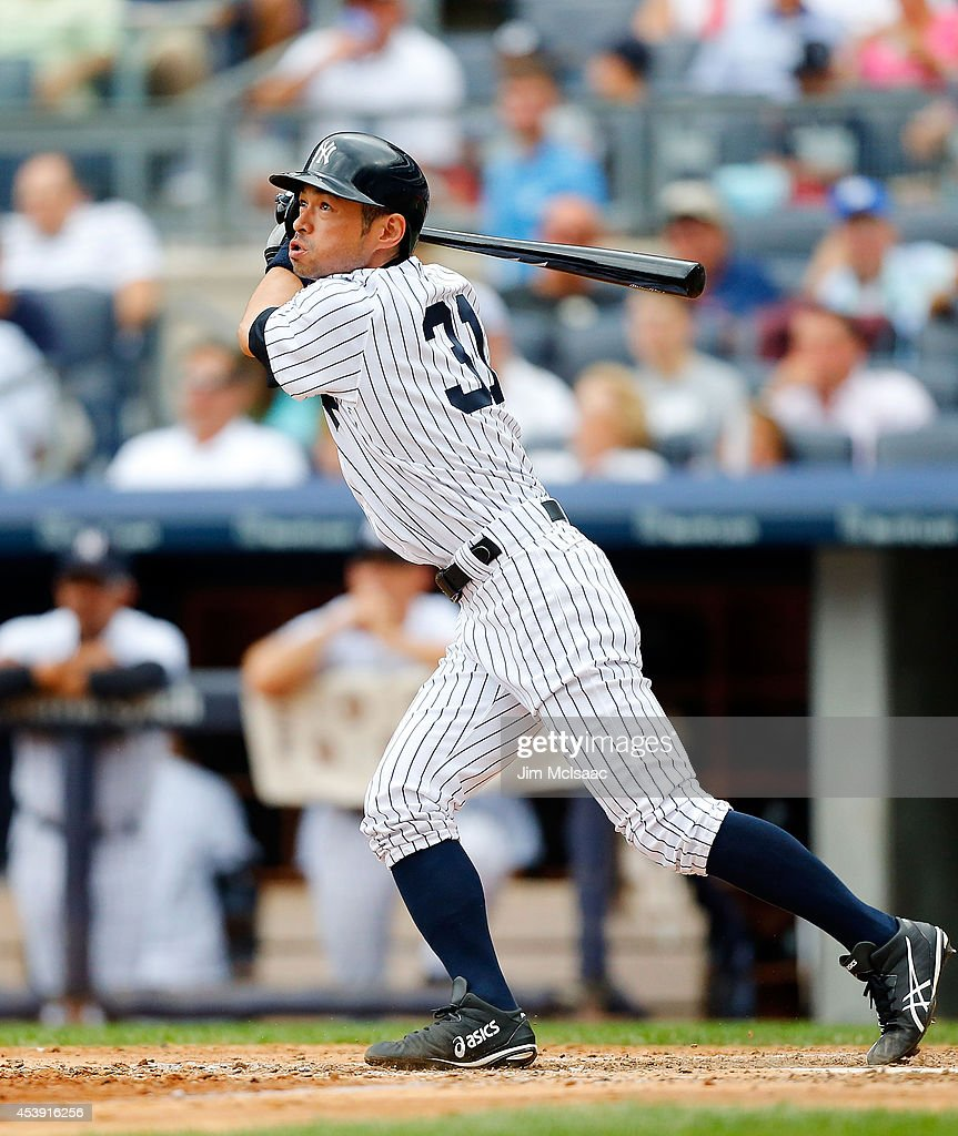 Ichiro Suzuki #31 of the New York Yankees flies out in the seventh inning against the Houston Astros at Yankee Stadium on August 21, 2014 in the Bronx borough of New York City.