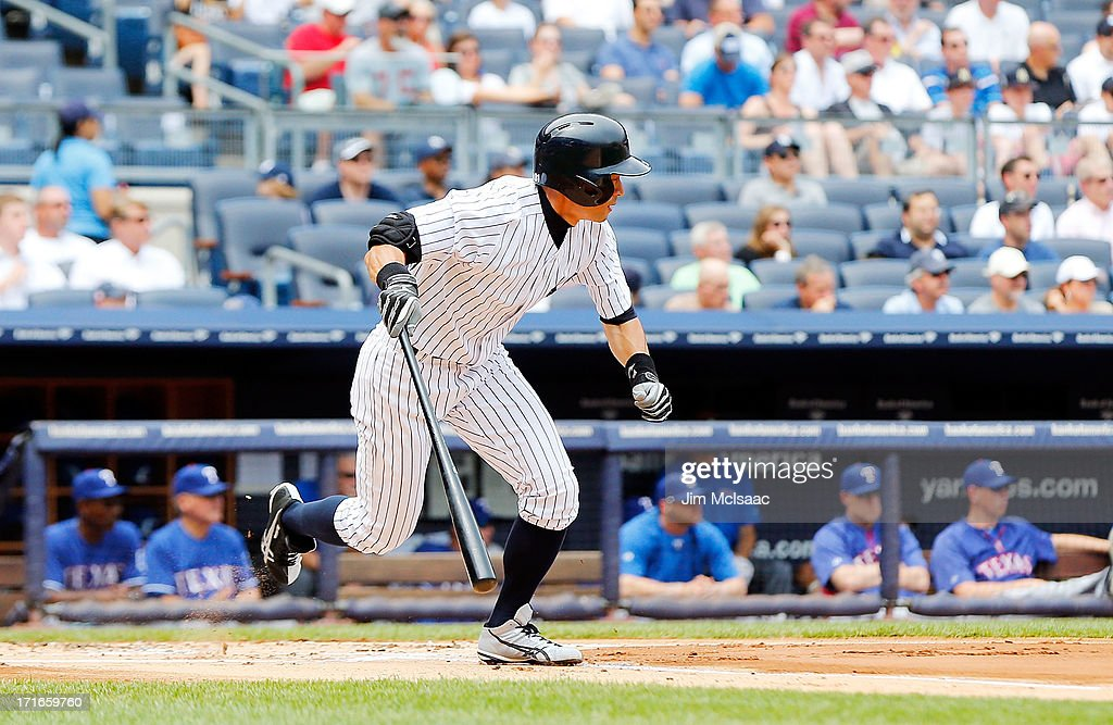 Ichiro Suzuki #31 of the New York Yankees follows through on a first inning base hit against the Texas Rangers at Yankee Stadium on June 27, 2013 in the Bronx borough of New York City.