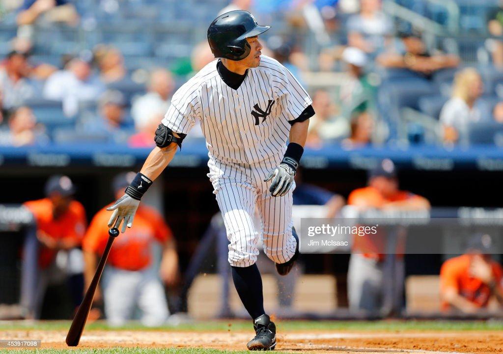 Ichiro Suzuki #31 of the New York Yankees follows through on a second inning run scoring sacrifice fly against the Houston Astros at Yankee Stadium on August 21, 2014 in the Bronx borough of New York City.