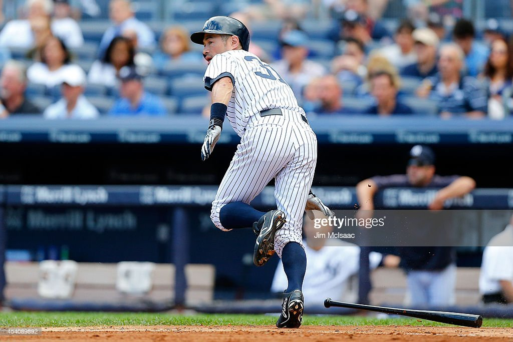Ichiro Suzuki #31 of the New York Yankees follows through on a third inning base hit against the Chicago White Sox at Yankee Stadium on August 24, 2014 in the Bronx borough of New York City. The Yankees defeated the White Sox 7-4 in ten innings.