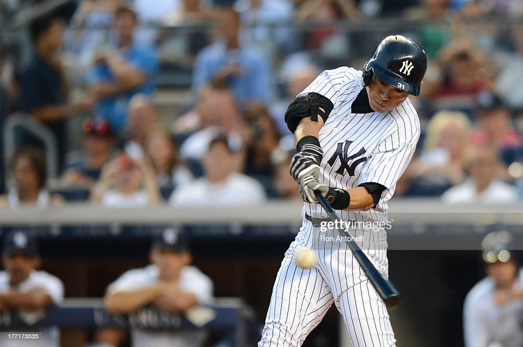 Ichiro Suzuki #31 of the New York Yankees gets his 4,000th career hit on a single in the 1st inning of the New York Yankees game against the Toronto Blue Jays at Yankee Stadium on August 21, 2013 in the Bronx borough of New York City.