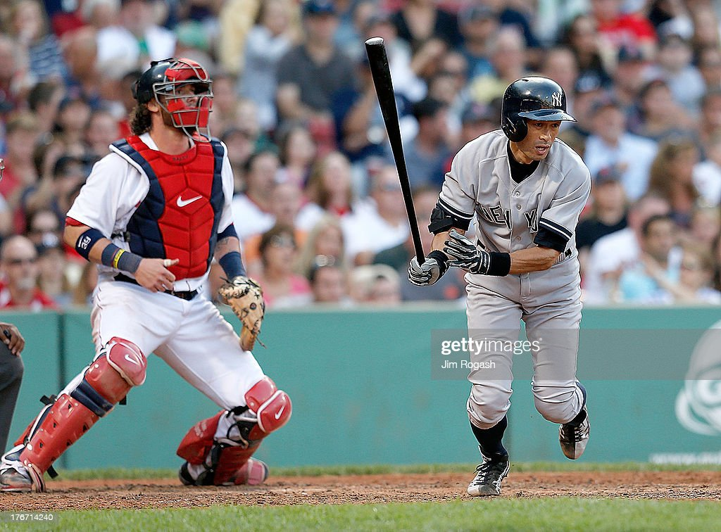 Ichiro Suzuki #31 of the New York Yankees grounds out to first base as Jarrod Saltalamacchia #39 of the Boston Red Sox watches at Fenway Park on August 17, 2013 in Boston, Massachusetts.