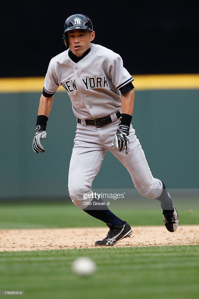 <a gi-track='captionPersonalityLinkClicked' href=/galleries/search?phrase=Ichiro+Suzuki&family=editorial&specificpeople=201556 ng-click='$event.stopPropagation()'>Ichiro Suzuki</a> #31 of the New York Yankees heads home to score the winning run past an RBI single by Chris Stewart against the Seattle Mariners in the ninth inning at Safeco Field on June 9, 2013 in Seattle, Washington. The Yankees defeated the Mariners 2-1.